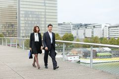 Economists male and female in strict suits walking. Economists walk during lunch break, married American middle-aged couple going to have snack. Man and women stock photos