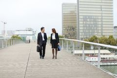 Economists male and female in strict suits walking. Economists walk during lunch break, married American middle-aged couple going to have snack. Man and women stock photo