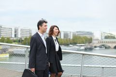 Economists male and female in strict suits walking. Economists walk during lunch break, married American middle-aged couple going to have snack. Man and women stock photography