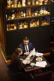 Economists in restaurant stock photo
