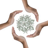 Economize the money. Some hands protecting a lot of dollars Stock Photography