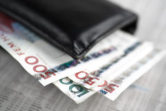 Economy. Swedish money on a newspaper Royalty Free Stock Images