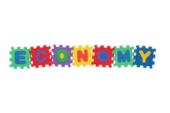 Economy. Word Economy, from letter puzzle, isolated on white background Stock Photos