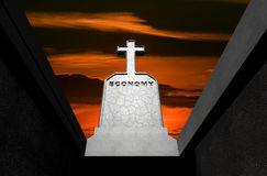 Economy. Word carved on gravestone Stock Photography