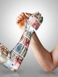 Economy arm wrestling royalty free stock image