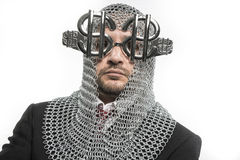 Economy, businessman with medieval executioner in metal and silv Royalty Free Stock Images
