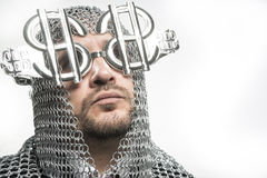 Economy, businessman with medieval executioner in metal and silv Royalty Free Stock Photos