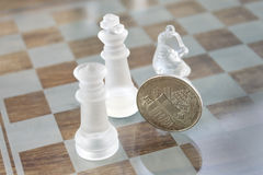 Economy is a chess match Stock Images
