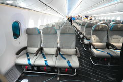 Economy class seats in a Boeing 787 Dreamliner at Singapore Airshow 2012 royalty free stock images