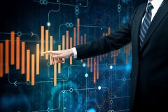 Economy concept. Businessman pointing at abstract forex chart. Economy concept. Double exposure Stock Images