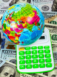 Economy concept. Globe in calculate on US dollar bill concept background, economy concept Stock Images