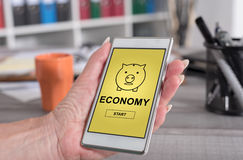 Economy concept on a smartphone Royalty Free Stock Image