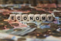 Economy - cube with letters, money sector terms - sign with wooden cubes Stock Image