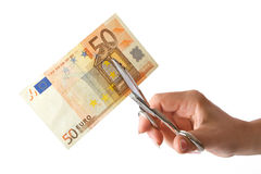 Economy cut. The female hand cuts the banknote with scissors Royalty Free Stock Image