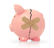 Economy failure concept. Broken piggy bank with band aid, white background Royalty Free Stock Photography