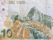 Approach to reverse side of a peruvian banknote of 10 soles, background and texture. Economy and finance, backdrop for trading and exchange announcements, value stock image