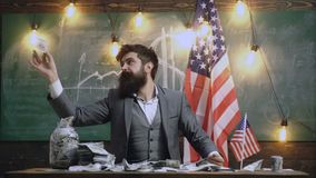 Economy and finance. Economy concept with bearded man holding money. Man puts money in a bank. Charity, finances. Funding, investment and people concept. Man stock footage