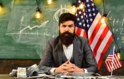 Economy and finance. Patriotism and freedom. American education reform at school in july 4. Income planning of budget. Increase policy. Bearded man with dollar Royalty Free Stock Images