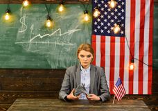 Economy and finance. Patriotism and freedom. American education reform at school in july 4th. Income planning of budget. Increase policy. Woman with dollar Royalty Free Stock Photo