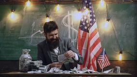 Economy and finance. Patriotism and freedom. Income planning of budget increase policy. Bearded man with dollar money. For bribe. American education reform at stock video footage
