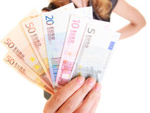 Economy finance. Woman holds euro currency money. Stock Photography