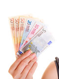 Economy finance. Woman holds euro currency money. Stock Photos
