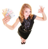Economy finance. Woman holds euro currency money. Stock Image