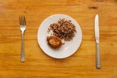 Economy food. rissole and buckwheat groats Royalty Free Stock Photos