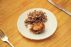 Economy food. rissole and buckwheat groats Royalty Free Stock Images