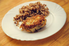 Economy food. rissole and buckwheat groats Stock Image