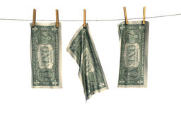 Economy hangs out to dry. Three one dollar bills hanging on a washing line to dry Royalty Free Stock Image