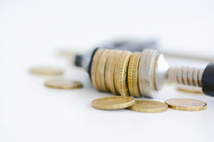 Economy pressure concept with stack of coins in a cramp Stock Photo