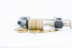 Economy pressure concept with stack of coins in a cramp Stock Images