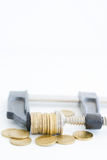Economy pressure concept with stack of coins in a cramp Royalty Free Stock Photos