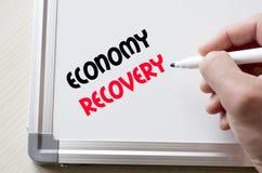 Economy recovery written on whiteboard Royalty Free Stock Photo
