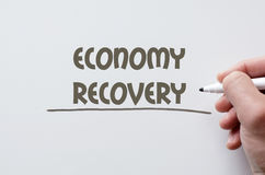 Economy recovery written on whiteboard Royalty Free Stock Image