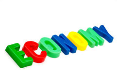 Economy spelled out in plastic letters Royalty Free Stock Images