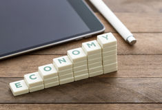 Economy. Text blocks as increasing graph bar. Economy infographic diagram on the wooden floor Royalty Free Stock Image