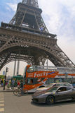 Economy to luxury contrast of transportation in Paris in front of Eiffel tower Royalty Free Stock Photography