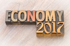 Economy 2017 word abstract in wood type Royalty Free Stock Images