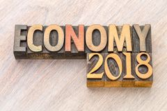 Economy 2018 word abstract in wood type Royalty Free Stock Photography