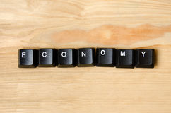 Economy word. With keyboard buttons Stock Photos