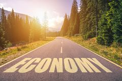 Economy word written on road in the mountains.  royalty free stock photo