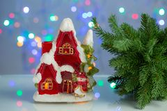 Ecorative cute red house with christmas tree on blue sparkling background. Christmas / New year beautiful backgrounds royalty free stock photos