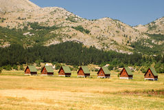 Ecotourism in mountains(Montenegro). Summer landscape with wooden huts for ecotourism in mountains(Montenegro royalty free stock images
