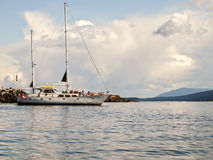 Ecotourism Sailing Tour. Group of happy sailors enjoying a day of ecotourism in southern British Columbia, Canada Stock Photo