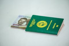 Ecowas Nigeria International Passport with 1000 naira currency notes royalty free stock images