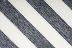 Ecru fabric in gray stripes, a background Stock Image