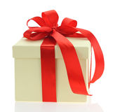 Ecru gift box with red ribbon Stock Image