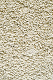 Ecru plaster from pebbles on wall closeup Royalty Free Stock Photo